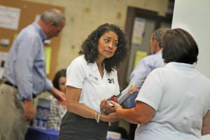 Andrew Dickerman/The Providence Journal Employment transition coordinator Linda McConney-Rico speaks with a recruiter at the Operation Stand Down job fair Thursday at CCRI's Knight Campus, in Warwick.
